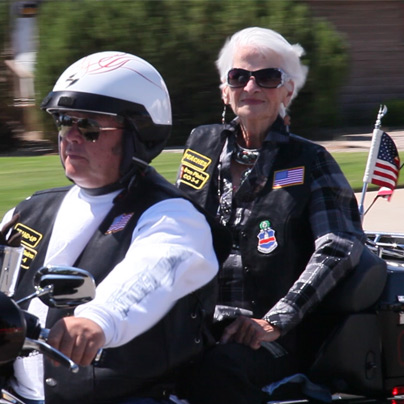 Seniors ride motorcycle in commercial still frame